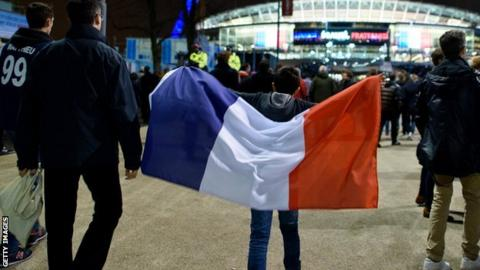 Fan carrying France flag