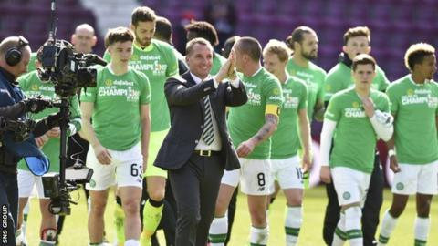 Celtic manager Brendan Rodgers and his players celebrate