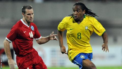 John Wilkinson playing for Singapore against Brazil's Anderson