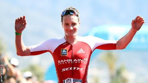 Alistair Brownlee celebrates finishing second at the Ironman in Marbella in April
