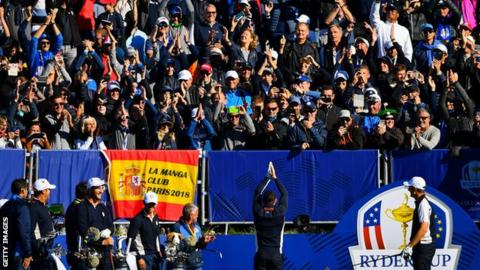 Europe's Rory McIlroy performs the viking clap in front of fans during a Ryder Cup practice round