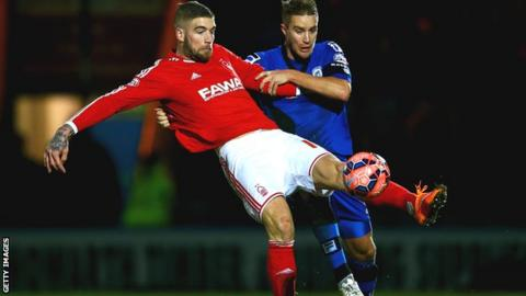 Nottingham Forest's Lars Veldwijk battles for possession with Oliver Lancashire of Rochdale in the FA Cup third round