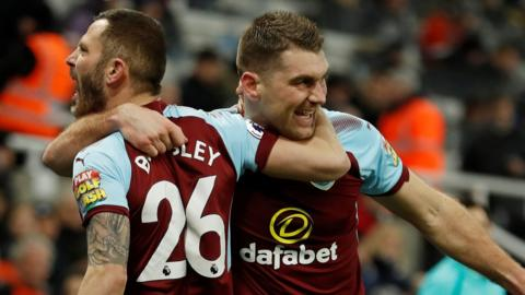 Burnley's Sam Vokes and Phil Bardsley after the equaliser with Newcastle