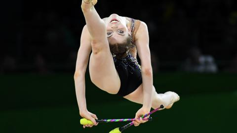 England's Hannah Martin competes in the clubs event of the rhythmic gymnastics individual all-around final during the 2018 Gold Coast Commonwealth Games at the Coomera Indoor Sports Centre on the Gold Coast on April 12, 2018