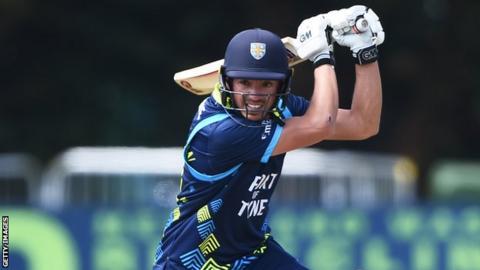 Durham batsman Tom Latham plays a shot