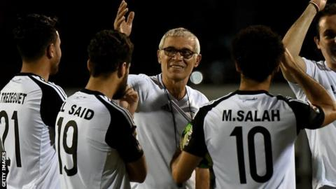 Egypt coach Hector Cuper speaks to his players during a training session