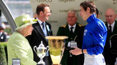 Her Majesty The Queen presents jockey James Doyle after his win aboard Blue Point