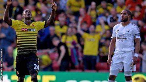 Ashley Williams looks on as Watford's Odion Ighalo celebrates