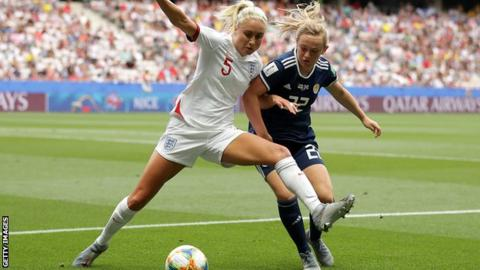 Steph Houghton challenges for the ball
