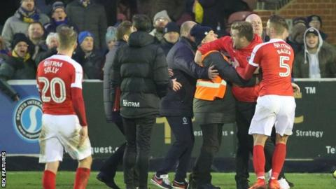 Karl Robinson (second right) has to be restrained at the end of Charlton's 1-1 draw with AFC Wimbledon