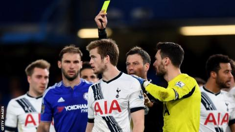 Mark Clattenburg and Eric Dier