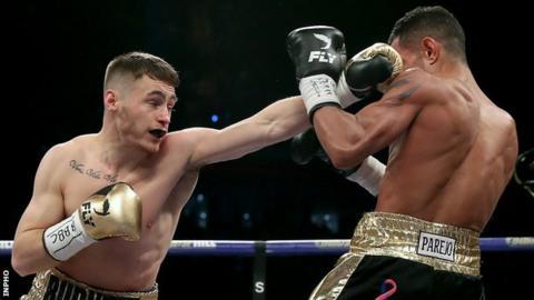Ryan Burnett lands a left on Yonfrez Parejo in the WBA world bantamweight title bout in Cardiff