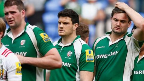 London Irish players following defeat by Harlequins