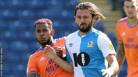 Leandro Bacuna of Cardiff and Bradley Dack of Blackburn Rovers