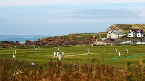 Bude, England, 6 July: Bude take on Menheniot/Looe in Division Two East of the Cornwall Cricket League at Crooklets Cricket Ground - which is in an idyllic setting on a cliff top that boasts views of the North Atlantic Ocean. (Photo by Dan Istitene/Getty Images)