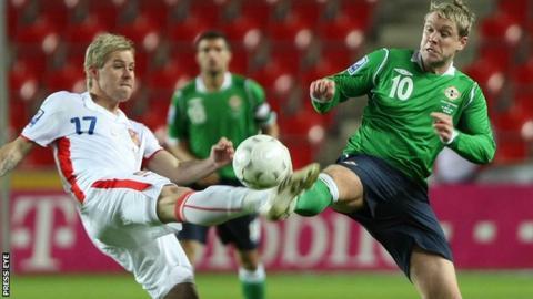 A Czech Republic player tackles NI's Grant McCann in the 2010 World Cup qualifier in Prague