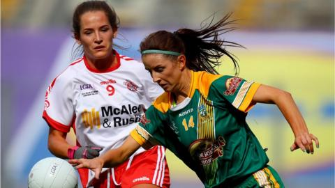Emma Jane Gervin of Tyrone closes in on Meath opponent Niamh O'Sullivan