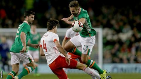Republic of Ireland striker Kevin Doyle was injured after colliding with Switzerland's Timm Klose