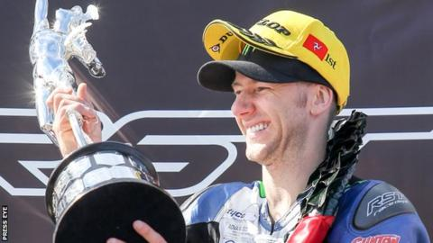 Ian Hutchinson celebrates his Superbike TT success on Saturday