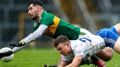 Kerry's Jack Sherwood and Conor McCarthy of Monaghan scramble for possession