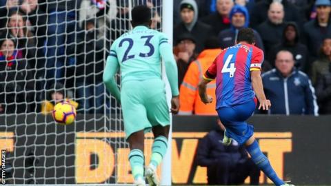 Luka Milivojevic scores from the penalty spot for Crystal Palace against Arsenal