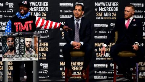 "Showtime Sports boss Stephen Espinoza (centre) said Mayweather was ""the number one attraction in sports and entertainment"""