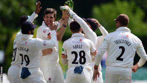 Somerset bowler Jamie Overton celebrates taking a wicket against Worcestershire