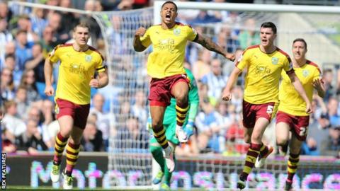 Andre Gray celebrates his goal for Burnley against Brighton