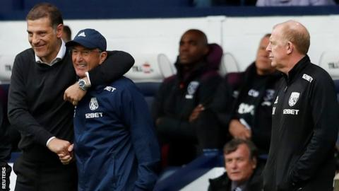 Slaven Bilic shakes hands with Tony Pulis as Gary Megson looks on