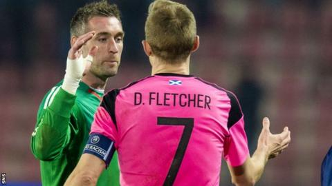 Scotland captain Darren Fletcher salutes goalkeeper Allan McGregor
