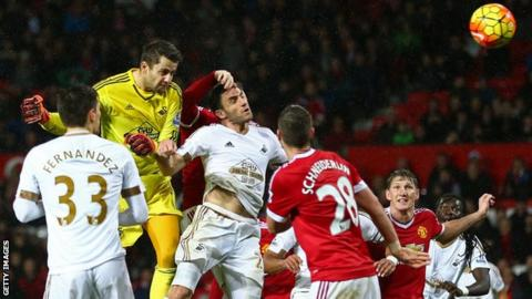 Swansea City goalkeeper Lukasz Fabianski heads inches wide in stoppage time