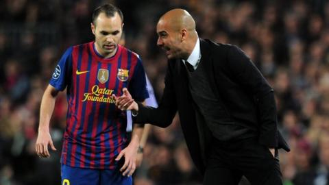 Pep Guardiola gives instructions to Andres Iniesta of Barcelona during the Champions League Semi Final, second leg match in 2012