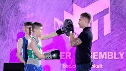 The boxer briefly turned trainer as he put the students through their paces