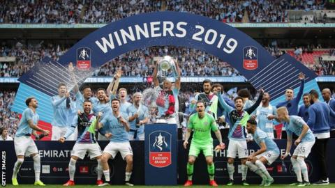 Manchester City celebrate with the FA Cup at Wembley