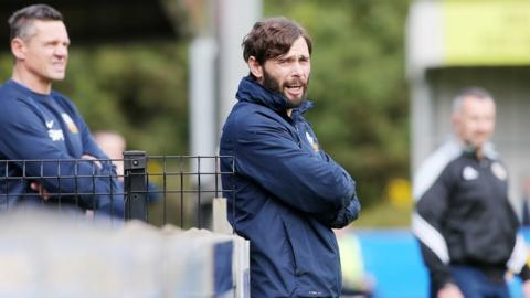 Glenavon manager Gary Hamilton looks on as his side canter to a second successive league win within the space of three days at Milltown