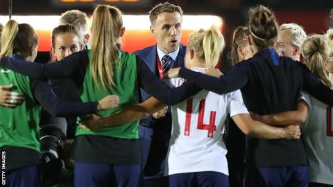 England women's manager Phil Neville and the team