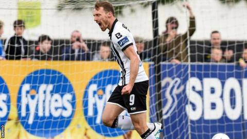 David McMillan celebrates after scoring his second-half penalty