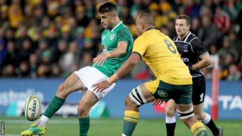 Australia's Caleb Timu attempts to charge down a Conor Murray kick in the Test series in June