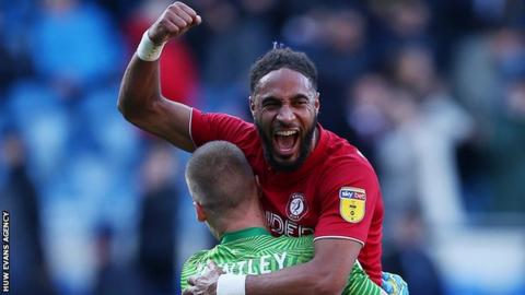 Ashley Williams celebrates with goalkeeper Daniel Bentley