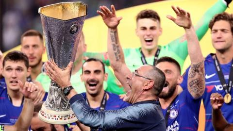 Former Chelsea manager Maurizio Sarri lifts the Europa League trophy