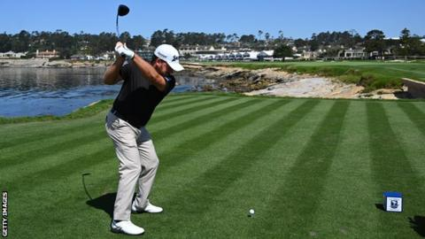 Graeme Mc Dowell drives off the 18th tee at Pebble Beach on Tuesday