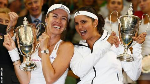 Martina Hingis and Sania Mirza celebrate winning the Wimbledon ladies' doubles title in 2015
