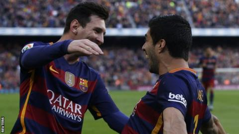 Lionel Messi and Luis Suarez celebrate against Atletico Madrid