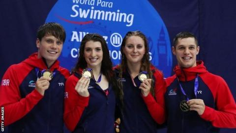 Thomas Hamer, Jessica Applegate, Bethany Firth and Reece Dunn of Great Britain with their gold medals after winning the mixed 4x100m freestyle relay S14 final at the 2019 World Para-swimming Championships in London.