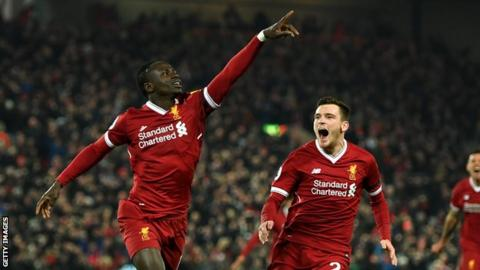 Sadio Mane celebrates with Andrew Robertson