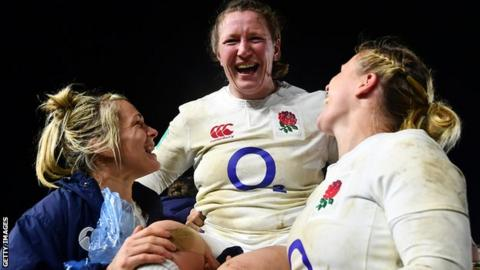 England's players lifted Rochelle Clark in tribute after the win