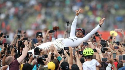 Lewis Hamilton celebrates winning the British Grand Prix