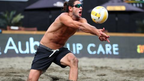 ISSAQUAH, WASHINGTON - JUNE 21: Raffe Paulis sets the ball while competing against Taylor Crabb and Jake Gibb during the AVP Seattle Open at Lake Sammamish State Park on June 21, 2019 in Issaquah, Washington. (Photo by Abbie Parr/Getty Images)