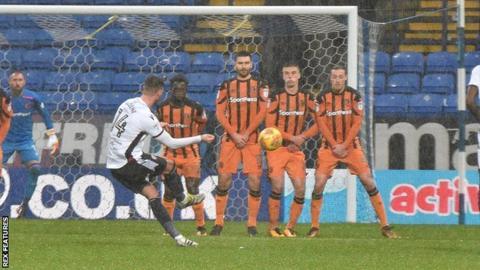 Bolton's Gary Madine scores a free-kick against Hull City