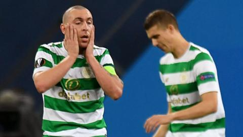 Celtic captain Scott Brown holds his head in his hands